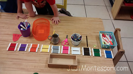 An extension of Color Box 2 : Children finding objects around the classroom that match color tablets.
