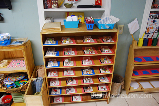 Letter Sound Shelf (shows coffee tray, necklaces, and letter tracing pages)